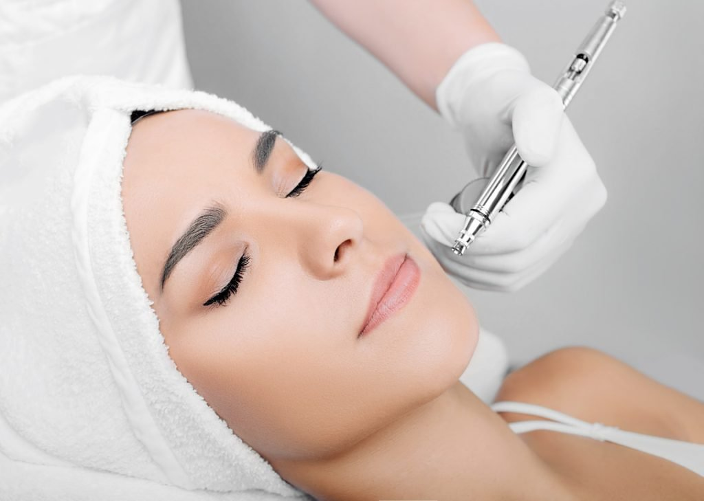 Woman receiving a Four in One super Facial by Ria Simpson at Darlings Faces